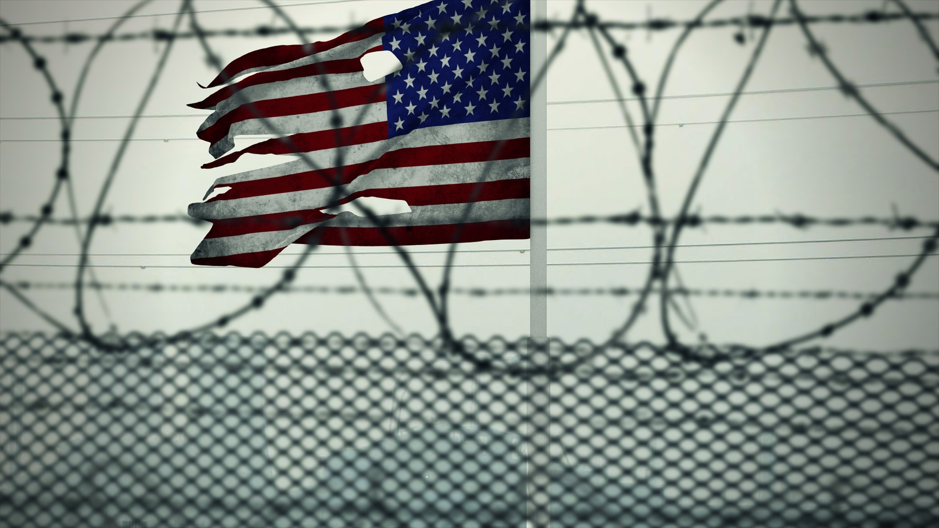American flag behind barbwire