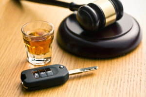 Alcohol and Car Key with Judges Gavel